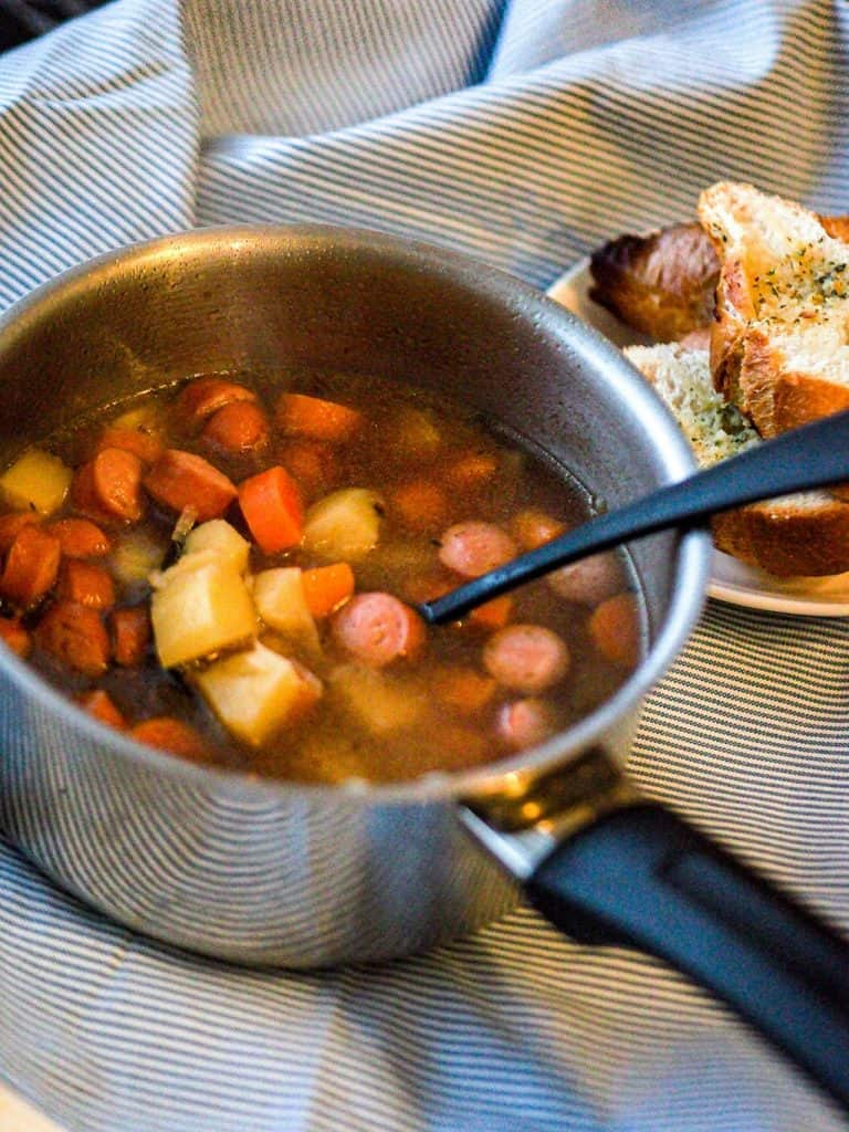 Nakkiketto or Finnish sausage soup in a pot